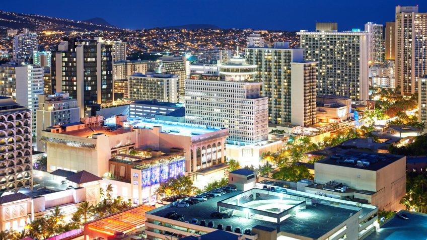Aerial view of Honolulu cityscape at night, Hawaii, USA.