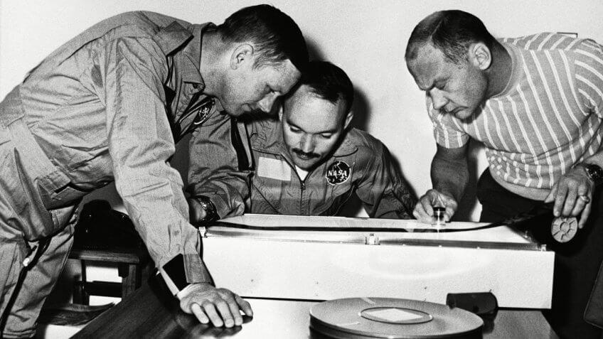 Apollo 11 astronauts examine film