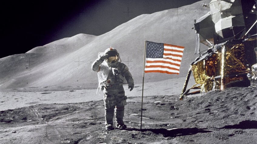 Astronaut David Scott saluting American flag