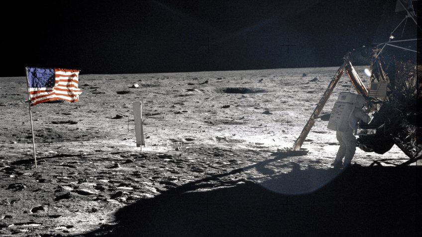 Astronaut Neil Armstrong standing on the moon