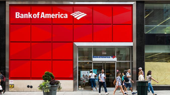 New York City, USA - July 31, 2018: Facade of a bank branch of Bank of America on the street with people around in New York City, USA - Image.