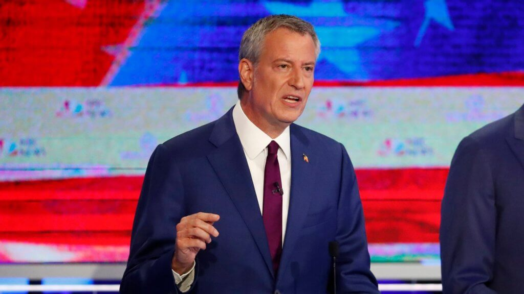 Mandatory Credit: Photo by Wilfredo Lee/AP/Shutterstock (10321970ah) Democratic presidential candidate New York City Mayor, Bill de Blasio, left, speaks during the Democratic primary debate hosted by NBC News at the Adrienne Arsht Center for the Performing Art, in Miami Election 2020 Debate, Miami, USA - 26 Jun 2019.