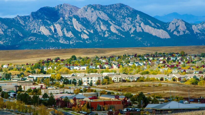 Broomfield, Colorado, USA - October 19, 2015: Urban sprawl from the developments in Broomfield, Colorado apprach the majestic range of the Flatiron Mountains.
