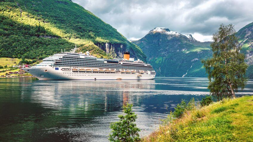 Dramatic summer scene of Geiranger port, western Norway.