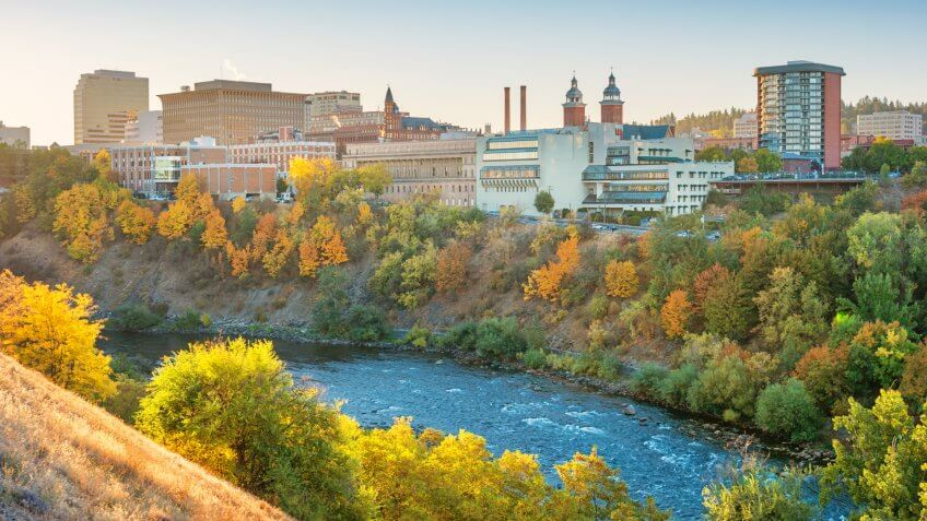 Stock photograph of the downtown Spokane, Washington skyline and the Spokane River at sunrise.