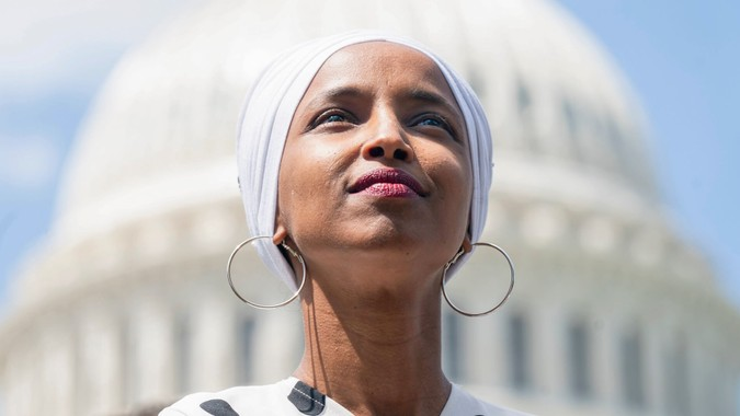 Mandatory Credit: Photo by JIM LO SCALZO/EPA-EFE/Shutterstock (10320500j)Democratic Representative from Minnesota Ilhan Omar listens to Independent Senator from Vermont Bernie Sanders (not pictured) speak to journalists about his plan to eliminate all $1.