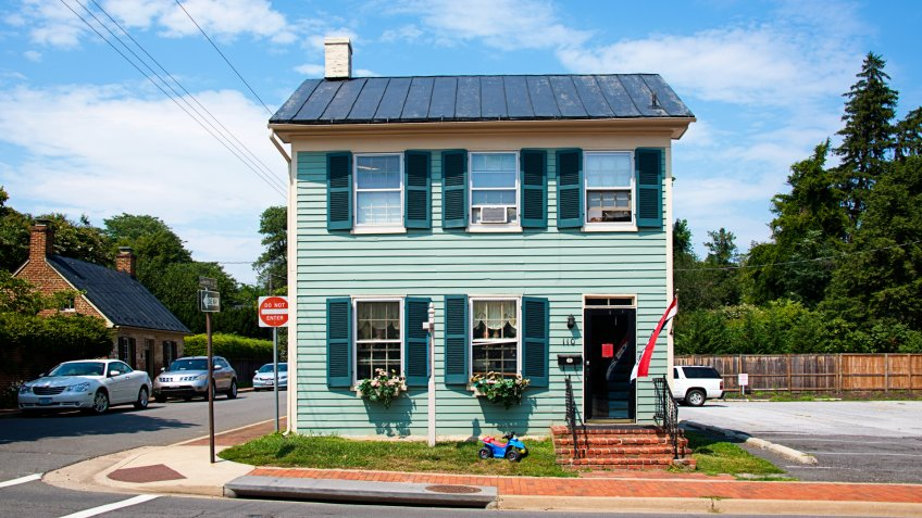Leesburg, USA - August 6, 2014: Main Street in Historic Town of Leesburg, Virginia with stores, restaurants and parked cars.