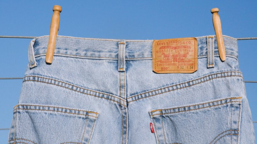 Levi Strauss denim jeans hanging on a laundry line