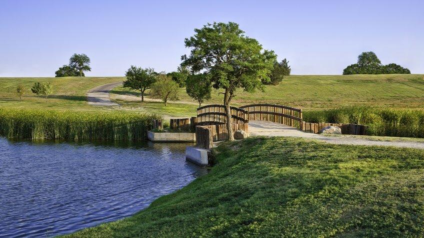 summer footbridge and lake In Lubbock Texas.
