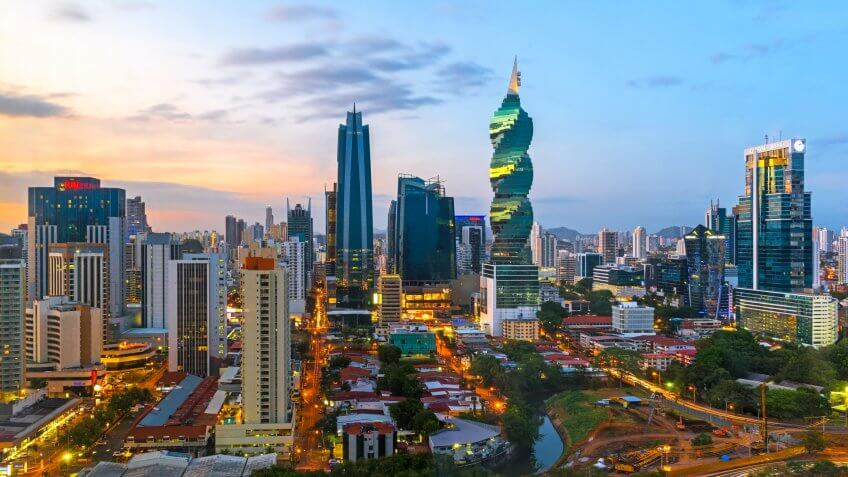 The colorful urban skyline of Panama city with a view over the financial district at sunset, Panama, Central America.