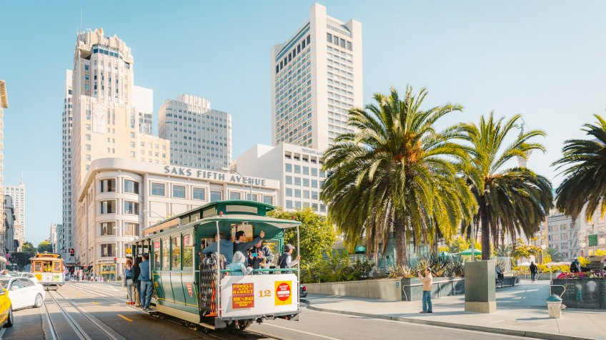SEPTEMBER 4, 2016 - SAN FRANCISCO: Traditional Powell-Hyde cable cars at Union Square in central San Francisco in beautiful golden morning light, California, USA.