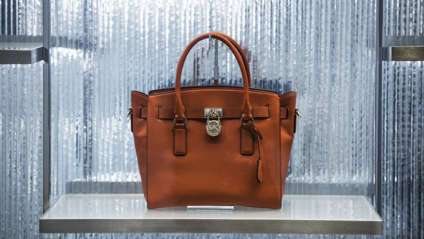 Simone manufactures luxury handbag like Michael Kors