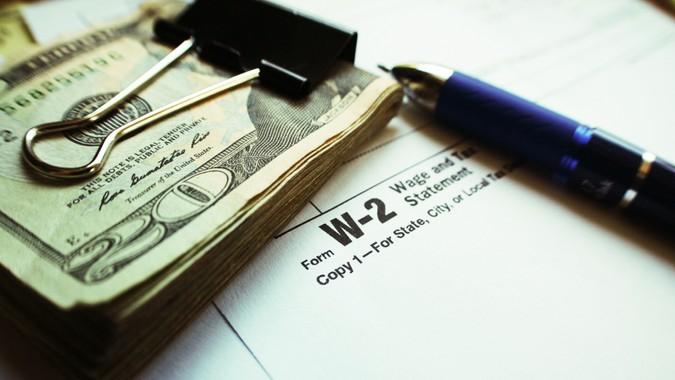 W-2 Tax form with Twenty Dollar Bills & Pen High Quality.