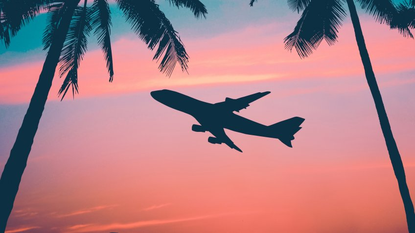 Retro Style Photo Of Plane Over Tropical Scene.