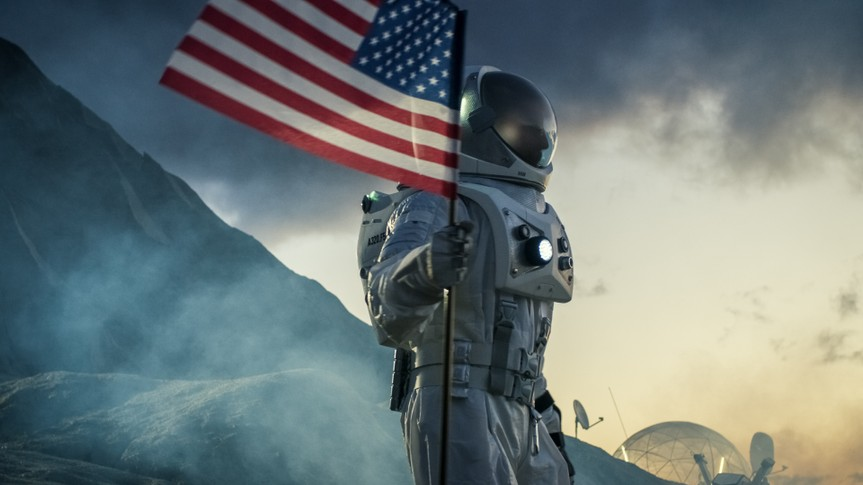 astronaut with American flag on moon