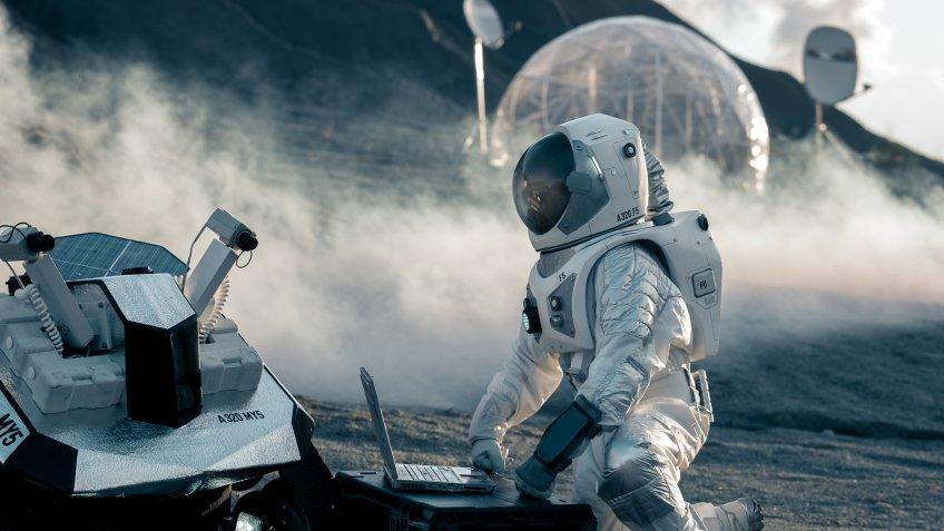 astronaut working on the moon