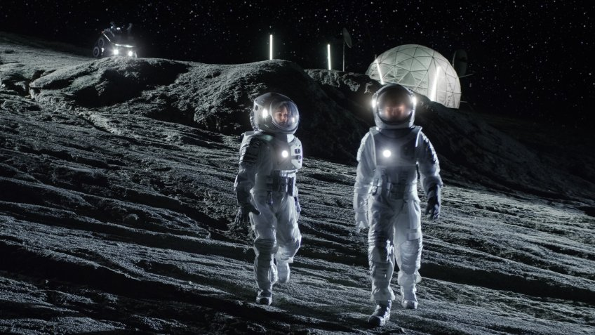 astronauts walking on the moon