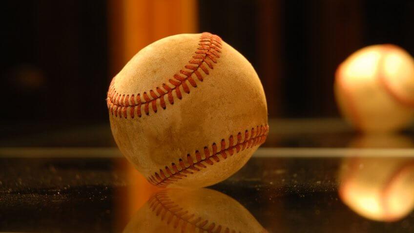 Baseball inside a glass trophy case.