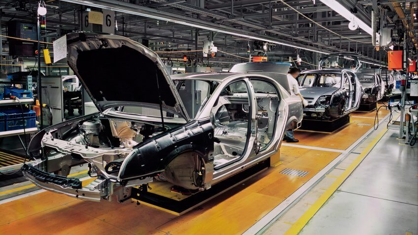 car production line with unfinished cars in a row.