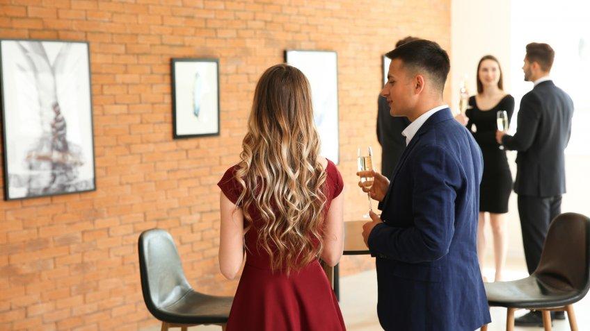 couple attending art gallery