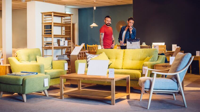 A middle aged couple are shopping in a furniture store for items for their new home.