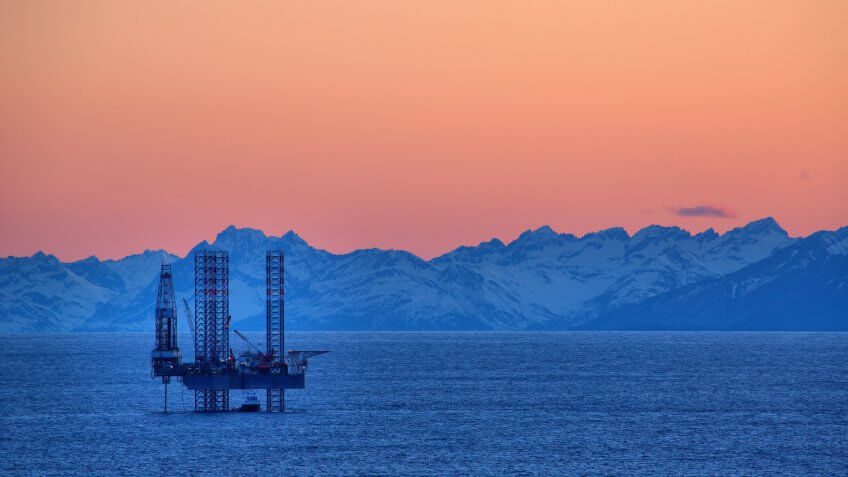 Sun sets on the Cook Inlet and this drilling rig.