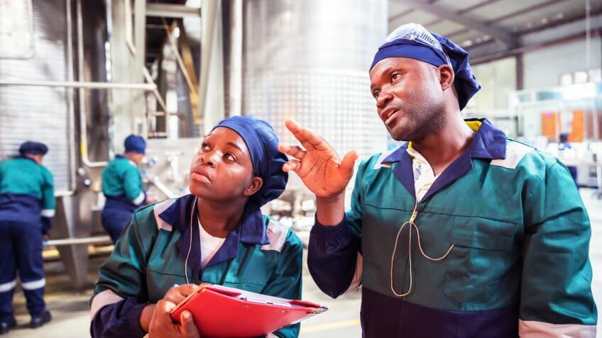 Factory, Inspection, Supervisor, Training - Factory Workers in Africa attending to their routines.