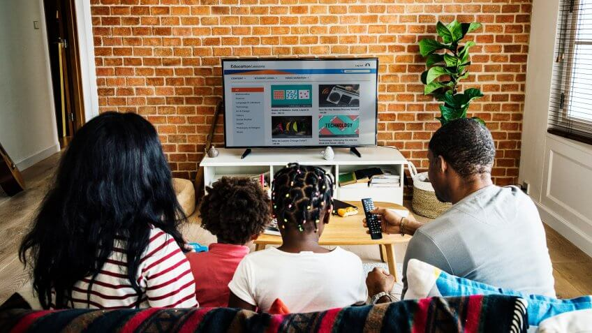 family watching on new television