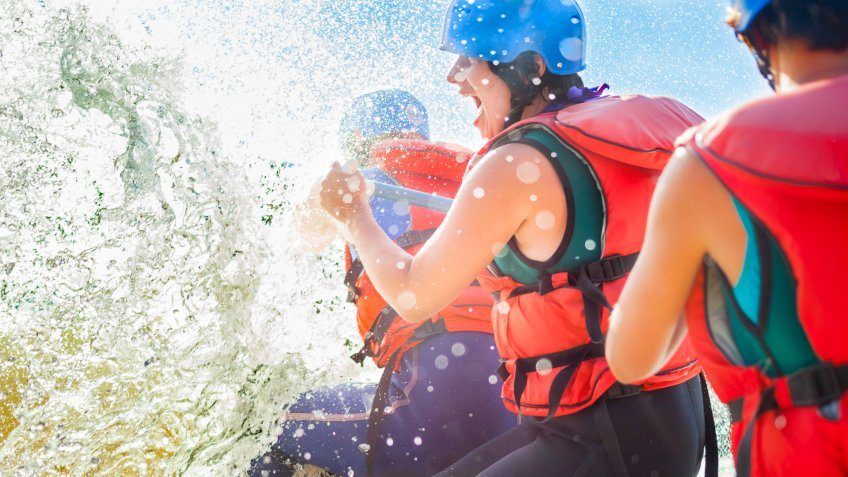 family white water rafting with safety vests