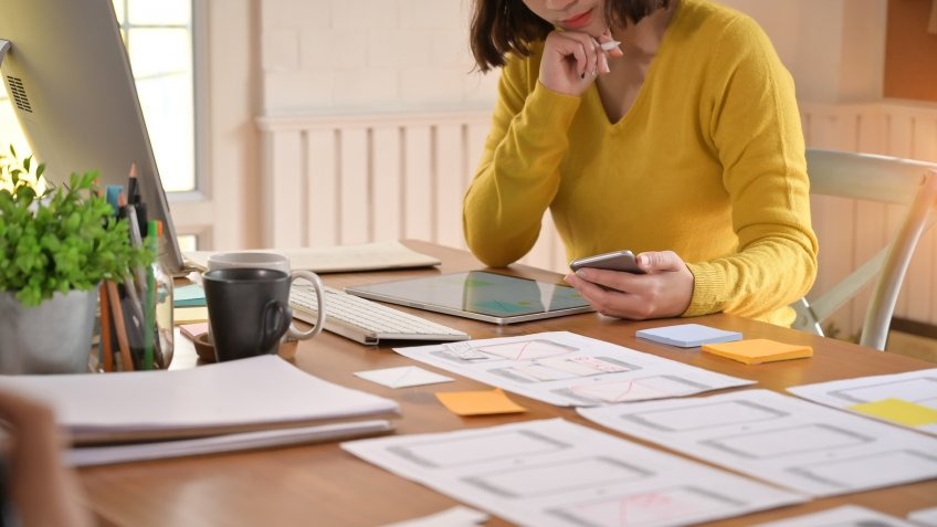 A female programer working with digital tablet a software developer job.