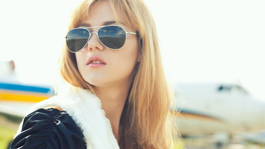 girl wearing aviator sunglasses