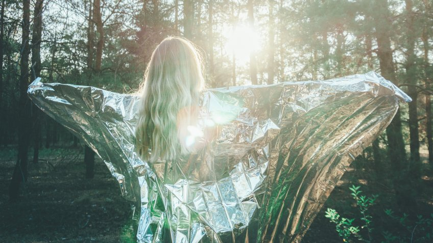 girl with foil blankets