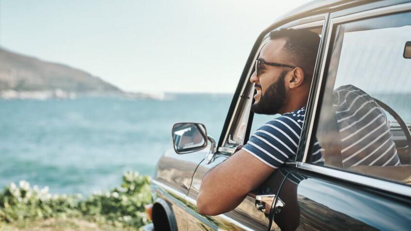Shot of a young man enjoying a road trip.