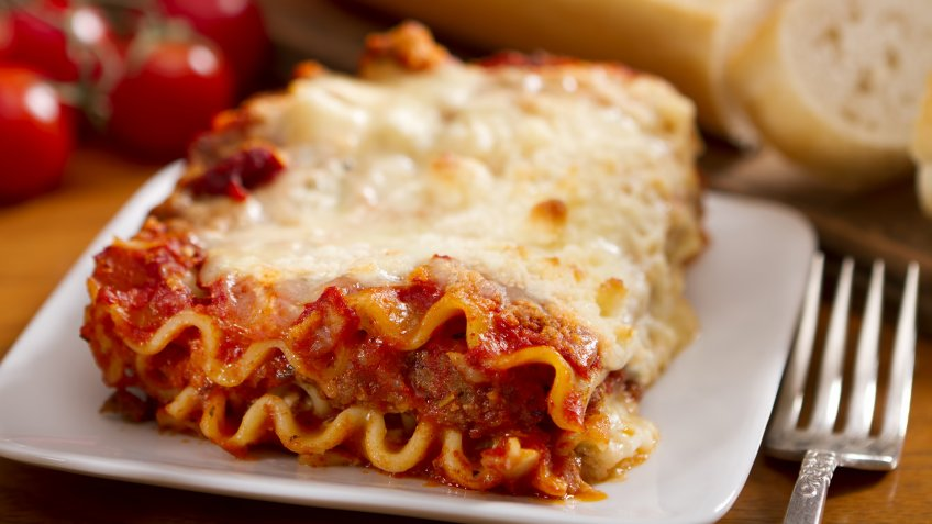 A single serving of freshly made meat and cheese lasagna.