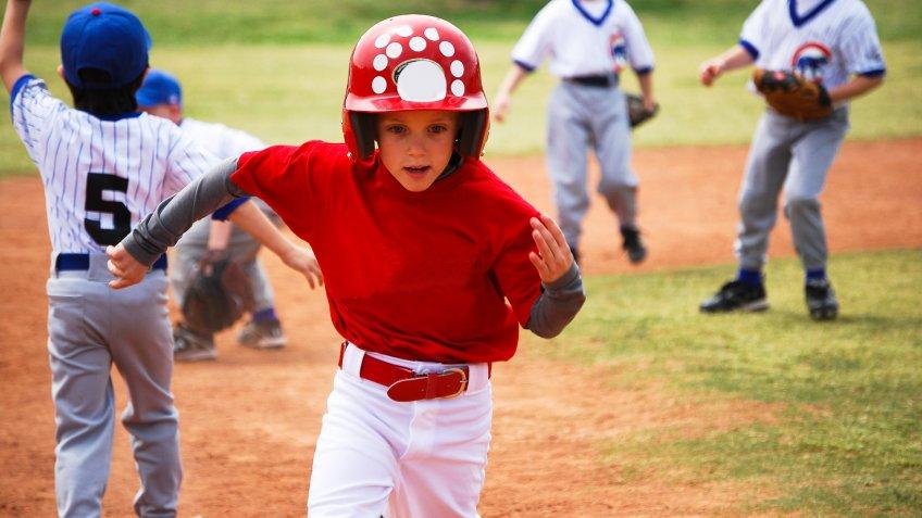 little kid running playing baseball