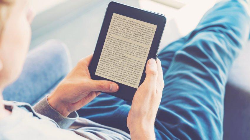 man reading an e-reader