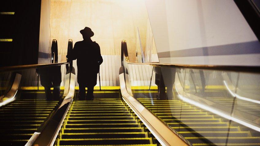 Escalator and old man.