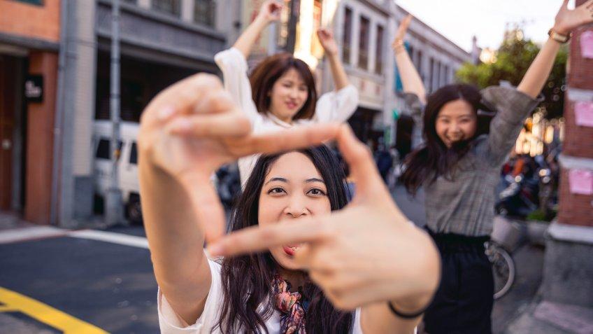 millennial friends jumping for photo