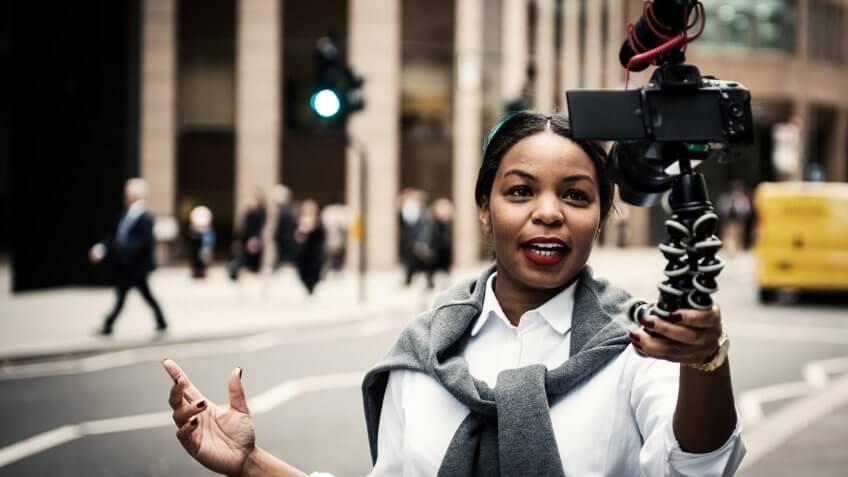 Businesswoman vlogging in London.