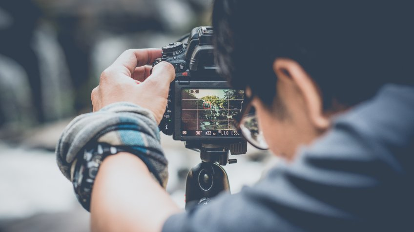 photographer capturing nature for stock photos