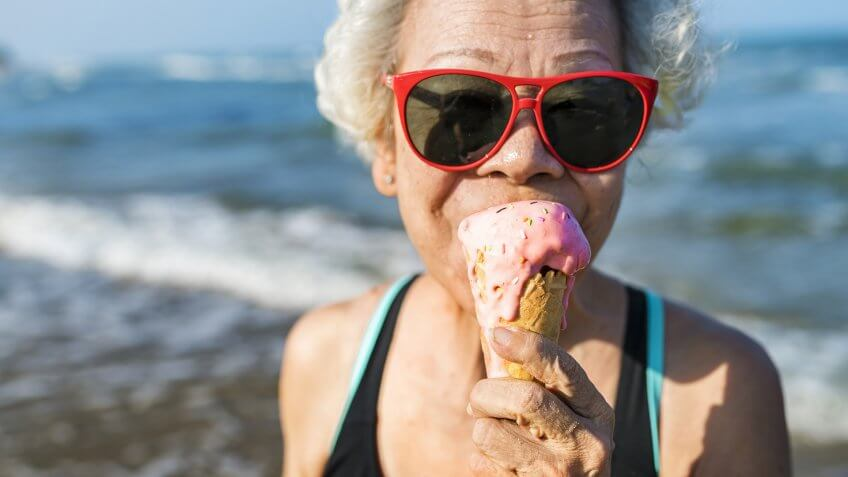 Senior woman eating an ice-cream.