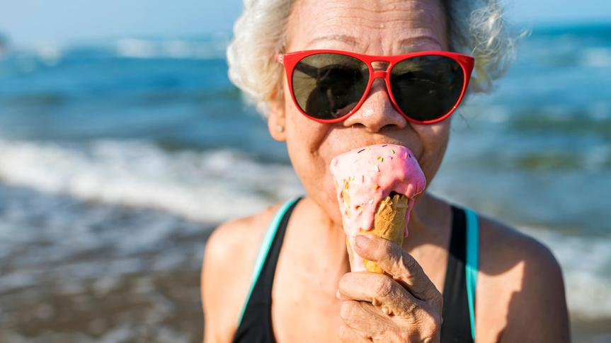 Senior woman eating an ice-cream.
