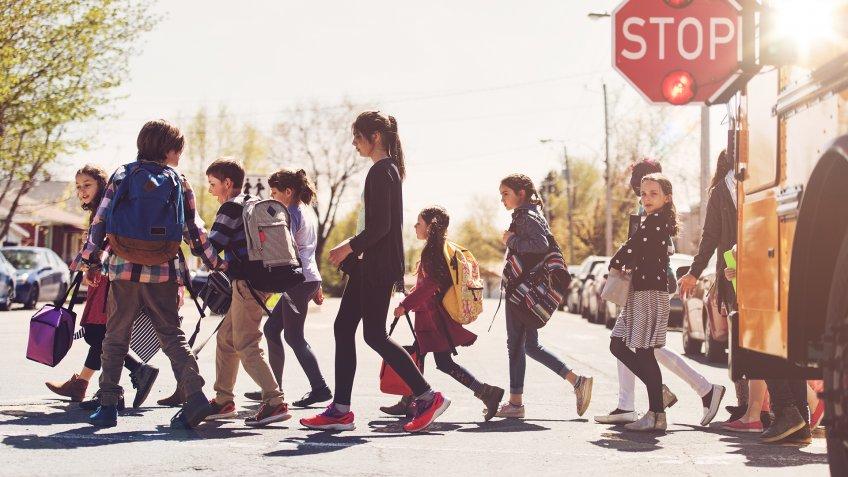 School kids crossing street.