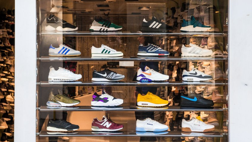 London, UK - 21 March, 2018: retail display of trendy sneakers displayed in the window of a shoe shop in central London, UK.