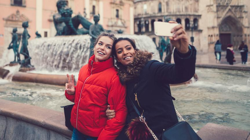 Two friends at a vacation in Valencia taking selfie.