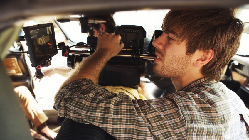 Camera operator shooting handheld.
