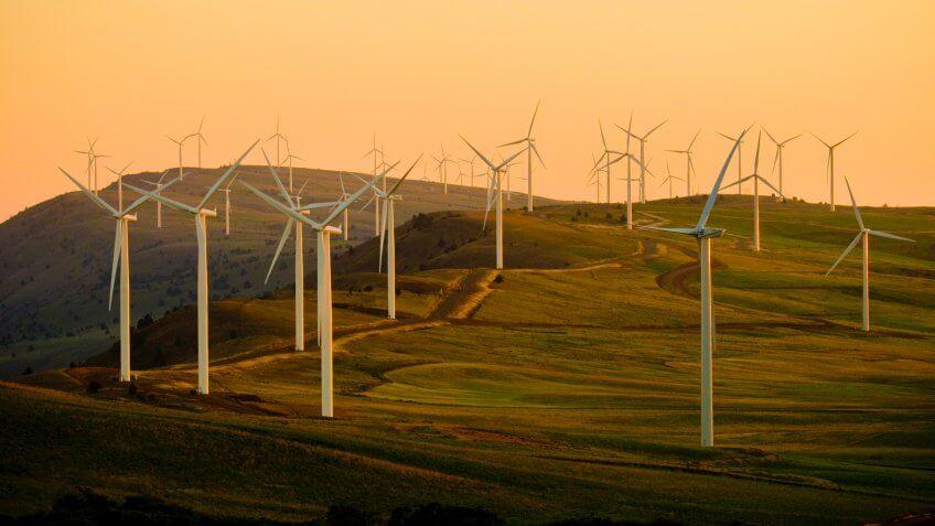 windmills on green field under white sky during daytime