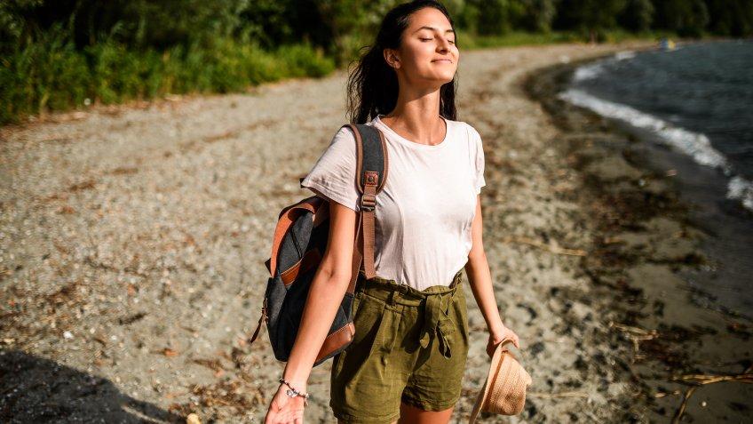 Beautiful hispanic woman enjoying beautiful air of nature.