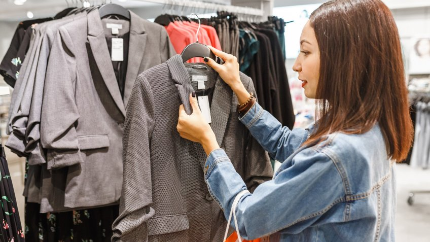 woman checking price on clothing sale