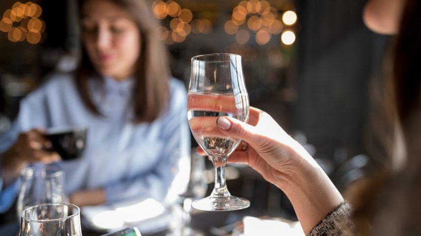 Businesswomen on coffee break, drinking water and coffee.